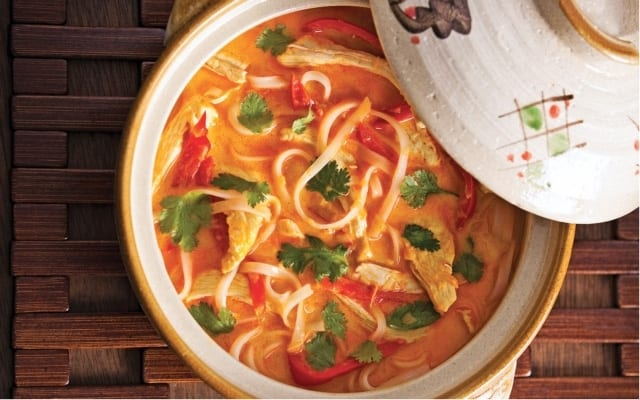 Spicy chicken soup with coconut milk
